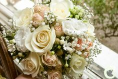 Bridesmaids bouquets of ivory and blush pink roses with gypsophila and greenery