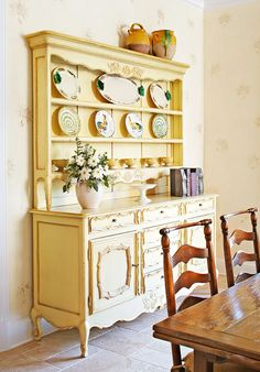 Breakfront displaying collection of rooster-motif and other plates is a reproduction French vaisselier with a yellow-painted finish. room design yellow Smart Downsize: Comfortable and Beautiful Chair Makeover, Furniture Makeover, Diy Furniture, Painting Furniture, Kitchen Furniture, Sunroom Furniture, Kitchen Dresser, Kitchen Cabinets, China Cabinets