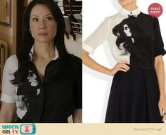 Joan's black and white dress with girl's face print on Elementary. Outfit Details: http://wornontv.net/21792 #Elementary