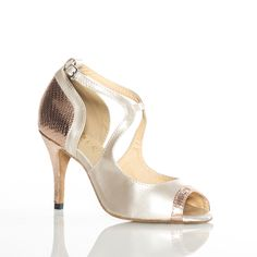 Burju Shoes : Anya, 3.5 inch stiletto in light tan patent with salmon metallic detail.  Simple yet glamourous.  A must have neutral for your closet.