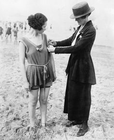 Chicago policewomen checking for violations of the bathing suit-length laws, 1921