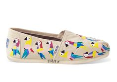 Designed by Haitian artists from the TOMS Haiti Artist Collective, these hand-painted Classics feature a vibrant parrot print. The outsole of each pair displays the artist's signature, giving these TOMS Exclusives a unique, artisanal touch.