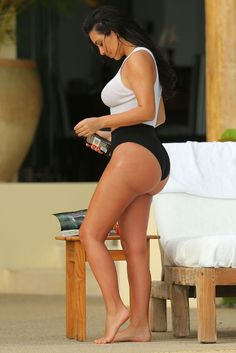 Kim Kardashian –  Wet and Wild - Kim Kardashian looks stunning in a see-through white tank top as she enjoys a second honeymoon in Mexico with Kanye West. The newly-weds stayed at the exclusive home of Girls Gone Wild founder Joe Francis, after jetting in to Punta Mita, to catch some pool side relaxation. The Wests honeymooned in Ireland and Prague after their May 24 wedding in Italy. (Photo by Brian Prahl/Splash News)