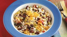 The perfect meal for when you don't have a lot of time: Try this cheesy rice, beans and vegetables one-dish recipe that's made right on the stove top
