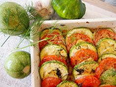 Baked zucchini,tomatoes and potatoes with parmesan. Delicious and light side dish!