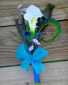 Calla lily peacock bouquet  for bridesmaids, single stem calla lily, purple and teal accent flowers. $18.00, via Etsy.
