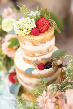 The naked cake trend is perfect for spring weddings! Top with fruit and fresh flowers