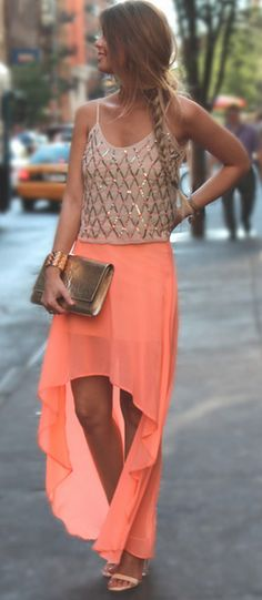 Nude diamond pattern tank top, a peach high-low skirt, and nude heels.