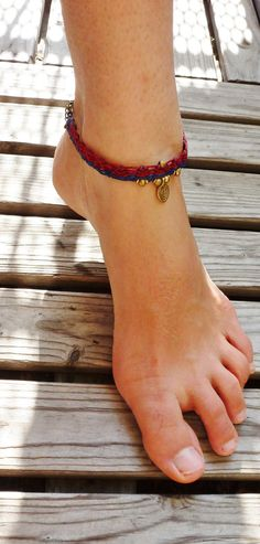 I made this beautiful,anklet in Germany August 2014.    Anklet characteristics:  Beads: Brass Beads, Brass Charm Thread: High quality polyester waxed thread (colour: red, blue) Closing: Clasp and chain, length adjustble Jewelery: Longlasting and washable    As I am travelling, my shop location might change after a few month.