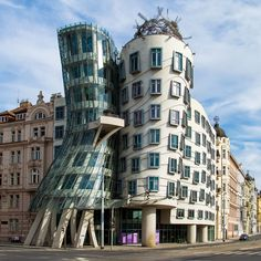 #UnusualBuilding - Dancing building- Praque, #Czech Republic. A modern, glass building surrounded by historic architecture, It was designed by the Croatian-Czech architect Vlado Milunić in co-operation with Canadian-American architect Frank Gehry on a vacant riverfront plot.
