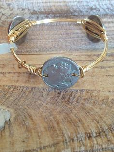 The Indian Nickel Bourbon and Boweties Bangle! In stock and $32 with Free Shipping! Perfect for Florida State Fans or Redskins Fans! www.facebook.com/twocumberland