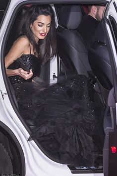 A tricky art to master: Amal managed to exit her car seamlessly, avoid all potential wardrobe malfucntions