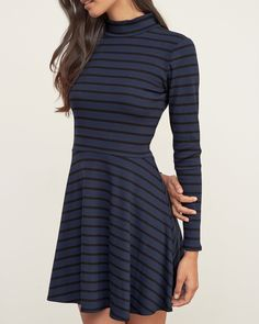 Womens Mockneck Skater Dress | Hit the city streets in a cozy dress, featuring a skater silhouette, a zipper closure at back and a mockneck, Flirty Fit | Abercrombie.com