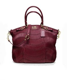 Coach satchel! Love everything about this bag..., color, size , shape , texture... Etc.