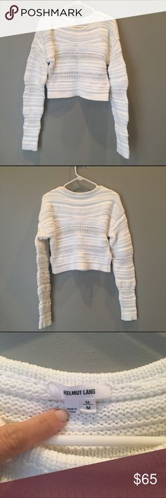 Helmut Lang Optic White Cropped Knit Sweater Loose knit cropped sweater by Helmut Lang in ultra bright optic white. Features a crew neckline and extra long sleeves. Perfect paired with a high-waisted skirt or jeans. Worn twice and freshly dry cleaned. No signs of wear. Helmut Lang Sweaters Crew & Scoop Necks