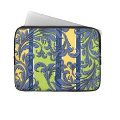 Unique, trendy and pretty laptop protection sleeve. Beautiful purple and blue ornate damask flower design on blue, yellow and green retro stripes pattern. For the fashionista or fashion diva, the hip decor trend setter, modern abstract or nouveau floral deco art motif lover. Cute and fun birthday gift or Christmas present. Classy, chic, elegant, original and cool protective laptop sleeve for the girly girl or the professional and sophisticated business woman.