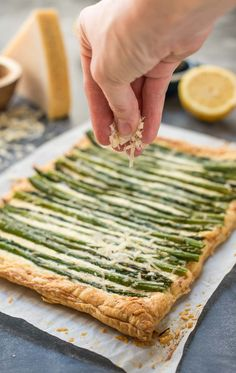 If you need a quick and elegant spring appetizer, look no further than this Parmesan Asparagus Tart with a puff pastry crust, creamy Parmesan ricotta filling, and fresh asparagus on top. Asparagus Appetizer, Asparagus Tart, Parmesan Asparagus, Asparagus Recipe, Fresh Asparagus, Elegant Appetizers, Appetizers For Party, Appetizer Recipes, Party Dips