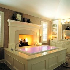 An infinity spa bathtub with chromotherapy lighting in the tub. And a fireplace--this is my dream spa bath!