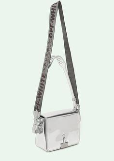 "Cross body leather flap bag in mirror silver with grey ""TIE DOWN"" Industrial belt strap. Height 17 cm. Width 19 cm. Depth 10 cm. Width shoulder strap 7 cm. Length ""TIE DOWN"" shoulder strap 162 cm."