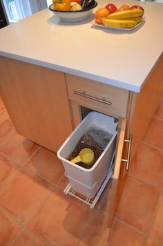 page 317- I like the idea of a pull out dog food bin. Nice to keep it in the kitchen but out of sight. by 1st Choice Cabinetry