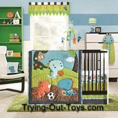 Dinosaur crib bedding window treatments and baby accessories for a prehistoric theme newborn nursery decor.