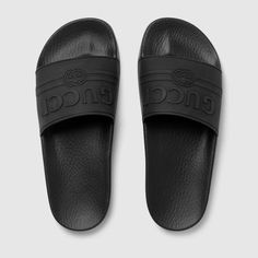Shop the Gucci logo rubber slide sandal by Gucci. Imbued with the summer feel permeating the Pre-Fall 2018 collection, the Gucci vintage logo - originally inspired by retro prints from the 80s - is reworked in bright-hued rubber and presented on a series of colorful slide sandals.