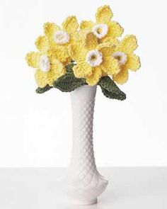 Pretty bouquet of daffodils will bring spring into your life all year round with their sunny, cheerful color. Crochet in Lily Sugar'n Cream Yellow, Sage Green, and Eggshell, size 4 mm (U.S. G or 6) hook. Glue & thread-coated wire required.
