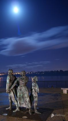 The statues along Derry's quays under October moonlight