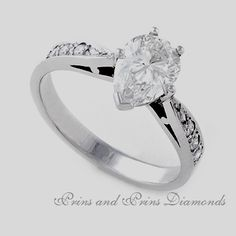 Centre diamond is a Pear cut diamond with round brilliant cut diamonds pave set in white gold Thing 1, Pear, Centre, Diamonds, Stones, White Gold, Engagement Rings, Jewelry, Enagement Rings