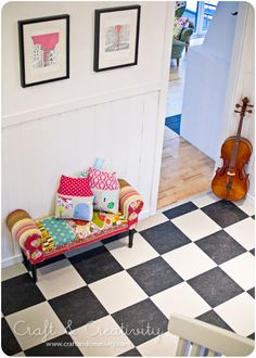 except that the cello in this pic is about to fall and crash any second... I LOVE THIS FLOOR.  (Not crisp colors like the eighties black and whites, but really nice.  what I want for the hallway and kitchen!!!- these tones or two brown and cream tones, not shiny)