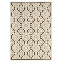"""Anchor your patio seating group or define space in the den with this artfully loomed indoor/outdoor rug, showcasing a quatrefoil ogee motif for eye-catching appeal.  Product: RugConstruction Material: PolypropyleneColor: Beige and blackFeatures:  Power-loomedMade in TurkeySuitable for indoor or outdoor use Pile Height: 0.25"""" Note: Please be aware that actual colors may vary from those shown on your screen. Accent rugs may also not show the entire pattern that the corresponding area rugs ..."""