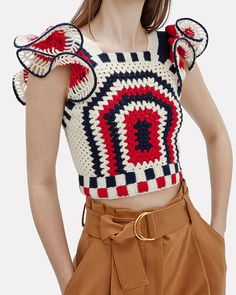 This artfully designed top features bold contrasting crochet segments with a large weave that allows for transparency. In red/white/blue. Crochet Skirt Outfit, Crochet Shirt, Crochet Crop Top, Crochet Jacket, Crochet Cardigan, Crochet Bikini, Crochet Fashion, Crochet Clothes, Pull