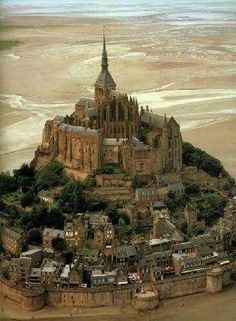 Mont Saint Michel, Normady, France, engulfed by the water at certain times revealing the splendor of construction. Set in a medieval town called Avranches, this monastery was fortified in the thirteenth century. Beautiful Places In The World, Places Around The World, Oh The Places You'll Go, Places To Travel, Places To Visit, Around The Worlds, Wonderful Places, Amazing Places, Travel Things