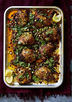 This spicy baked chicken is a Middle Eastern inspired supper that is so easy to make. This quick traybake combines the aromatic flavours of harissa with the freshness of preserved lemons for a really moreish finish. #chickenrecipes #traybakerecipes #easydinnerrecipes
