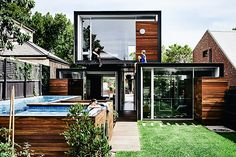 In a neighborhood filled with oversized homes, the Stamford House stands out not by the space it occupies, but the space it doesn't. The home, also referred to as That House, is constructed using three rectangular forms - two on...