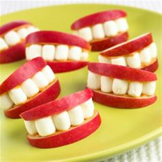 apples and peanut butter with marshmallow teeth- easy and fun!