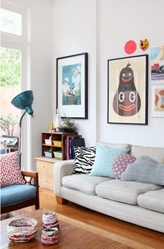 Love the prints on wall, small pigeon hole shelf and simply adore the blue sofa the woodwork is to die for.