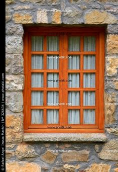 Rustic wood windows in a vertical stone wall.I like that orange Wooden Window Design, House Window Design, Wooden Windows, Door Design, Windows And Doors, Window Sill, Rustic Wood, My House, Exterior