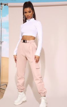 These joggers are our new off-duty go-to. Featuring a nude material with a buckle belt and elasticated cuffs, team them with a simple white crop top and chunky sneakers for an off-duty outfit we're loving. off duty NUDE UTILITY BUCKLE BELT JOGGERS Teen Fashion Outfits, Edgy Outfits, Swag Outfits, Mode Outfits, Retro Outfits, Look Fashion, Outfits For Teens, Summer Outfits, Sporty Fashion