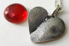 2 thumbprints into one heart necklace