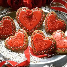 Elegant red, red, hearts with red lace, red flourishes, and red roses beautifully crafted by Teri Pringle Wood