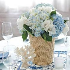 This rope-wrapped vase holds a beautiful arrangement of hydrangea and godetia.  It's quick and easy!