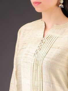Beige Tussar Silk Pleated Natural Dyed Tunic - Like the detail of the pleating on the side. Neck Designs For Suits, Neckline Designs, Dress Neck Designs, Blouse Designs, Salwar Designs, Kurta Designs Women, Silk Kurti Designs, Salwar Pattern, Kurta Patterns