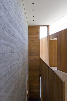 Concrete, plaster and wood. Nice combination by Clinton Murray Architects.