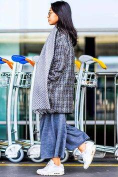 18 street style photos of chic travelers at Charles de Gaulle airport in Paris…