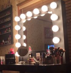 DIY HollyWood Style Vanity For Less Than 1/2 The Price Of Retail!! Glamour On A Budget!! DIY Glamorous Vanity that ANY girl would LOVE to have!! Save Those Bucks!! **SUPPLIES  1. Large Mirror 2. Globed Light Bulbs  3. Light Sockets 4. Acrylic Paint (If Wanted..) 5. Cable Holder 6. Wire Strips 7. Electrical Cord 8. Wire Caps 9. Drill 10. Hammer 11. Measuring Tape 12. Hot Glue Gun *Helpful Hint: Ensure that the mirror does not extend out into the frame. This is...