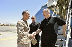 U.S. Deputy Defense Secretary Bob Work, right, speaks with Marine Corps Gen. Joseph F. Dunford Jr., commander of the International Security ...