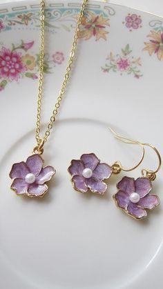 Bridesmaid Jewelry - Flower Necklace Earring Set - Lavendar and Gold Enamel Flower Charm - Wedding Jewelry - Gift for her Women. $34.00, via Etsy.
