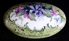 """Lovely porcelain ring/trinket/jewelry box measures 2-3/4"""" long and features floral violets and forget-me-not design. This piece is painted entirely by hand. No decals were applied for this decoration and it is signed by myself. $32.50 + $5.95 shipping"""