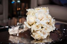 Heirloom jewelry on a gardinia and orchid bouquet